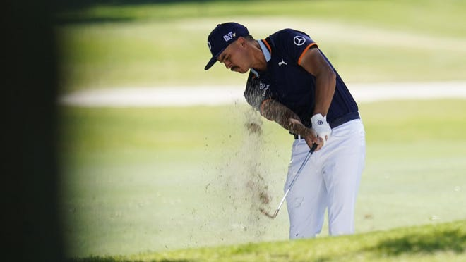 Rickie Fowler hits out of the sand on the seventh hole during the first round of the Charles Schwab Challenge golf tournament Thursday at the Colonial Country Club in Fort Worth, Texas.