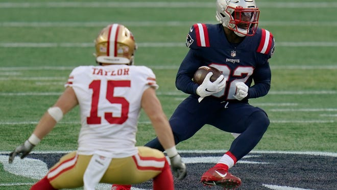 New England Patriots defensive back Devin McCourty, right, runs from San Francisco 49ers wide receiver Trent Taylor (15) after intercepting a pass in the first half of an NFL football game, Sunday, Oct. 25, 2020, in Foxborough, Mass.