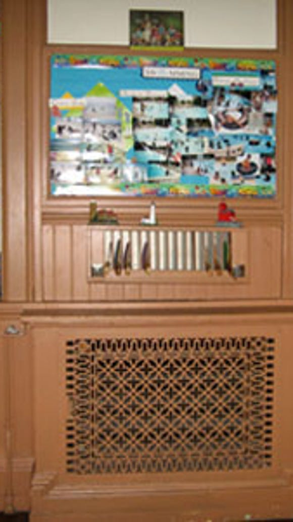 interior post office window and decorative heat grill