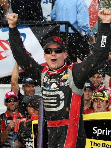 Jeff Gordon celebrates in victory lane after winning