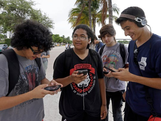 Pokemon Go players Brian Vega, left,  Peyton Ruiz,