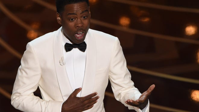 Actor Chris Rock presents on stage at the 88th Oscars on Sunday in Hollywood, California.