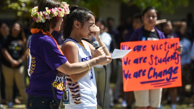 Freshmen Lola Aguon, 14, becomes emotional as she speaks about firearms being used in acts of school violence during an anti-gun rally at George Washington High School on Friday, April 20, 2018.