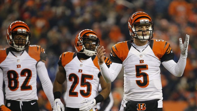 Bengals quarterback AJ McCarron looks for a play call during the first quarter against the Broncos.