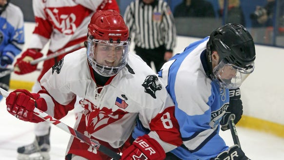 North Rockland's Luke MacMillan (8) tries to steal