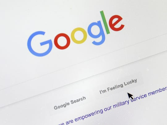 A cursor moves over Google's search engine page on