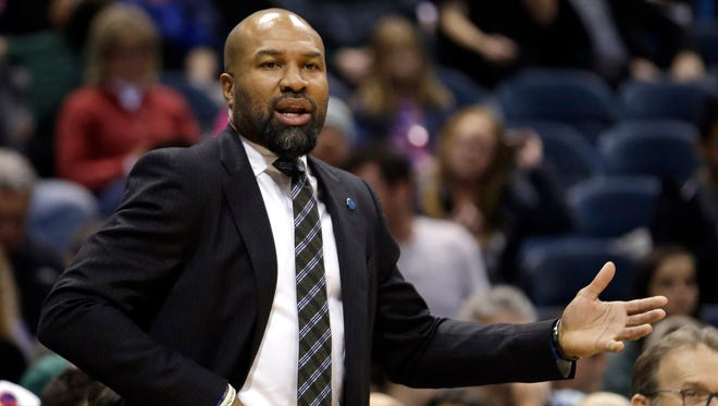 In this Dec. 5, 2015, file photo, Knicks coach Derek Fisher gestures during a game against the Milwaukee Bucks.
