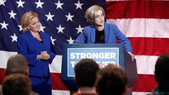 Sen. Elizabeth Warren (Carlie Craig), right, speaks after being introduced by Hillary Clinton (NIcole Sullivan) in a sketch from CW's revival of 'MADtv.'