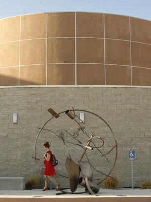 Art work  at the Palm Desert Campus - California State University, San Bernardino  frames a passing woman.
