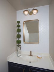 Powder room after renovation by POSH Exclusive Interiors.