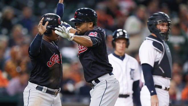 Indians leftfielder Coco Crisp celebrates his two-run homer with third baseman Jose Ramirez during the second inning Monday at Comerica Park.
