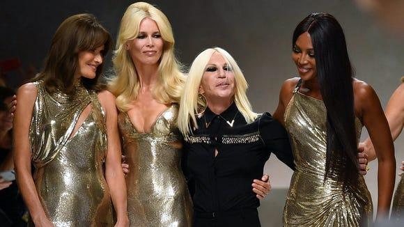 Donatella Versace poses with Carla Bruni, Claudia Schiffer