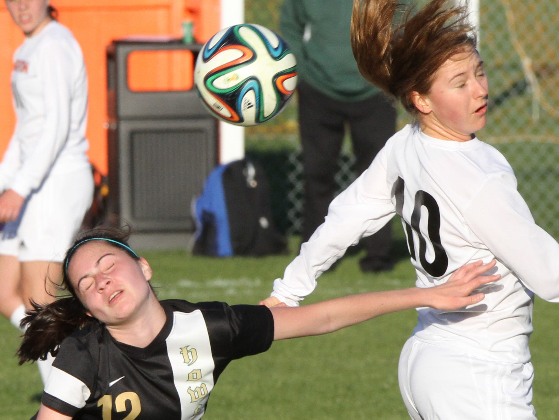 Howell's Lauren Yoder, left, and Brighton's Bailey Tuczak, right, jostle for position in a game Brigthton won, 2-0.