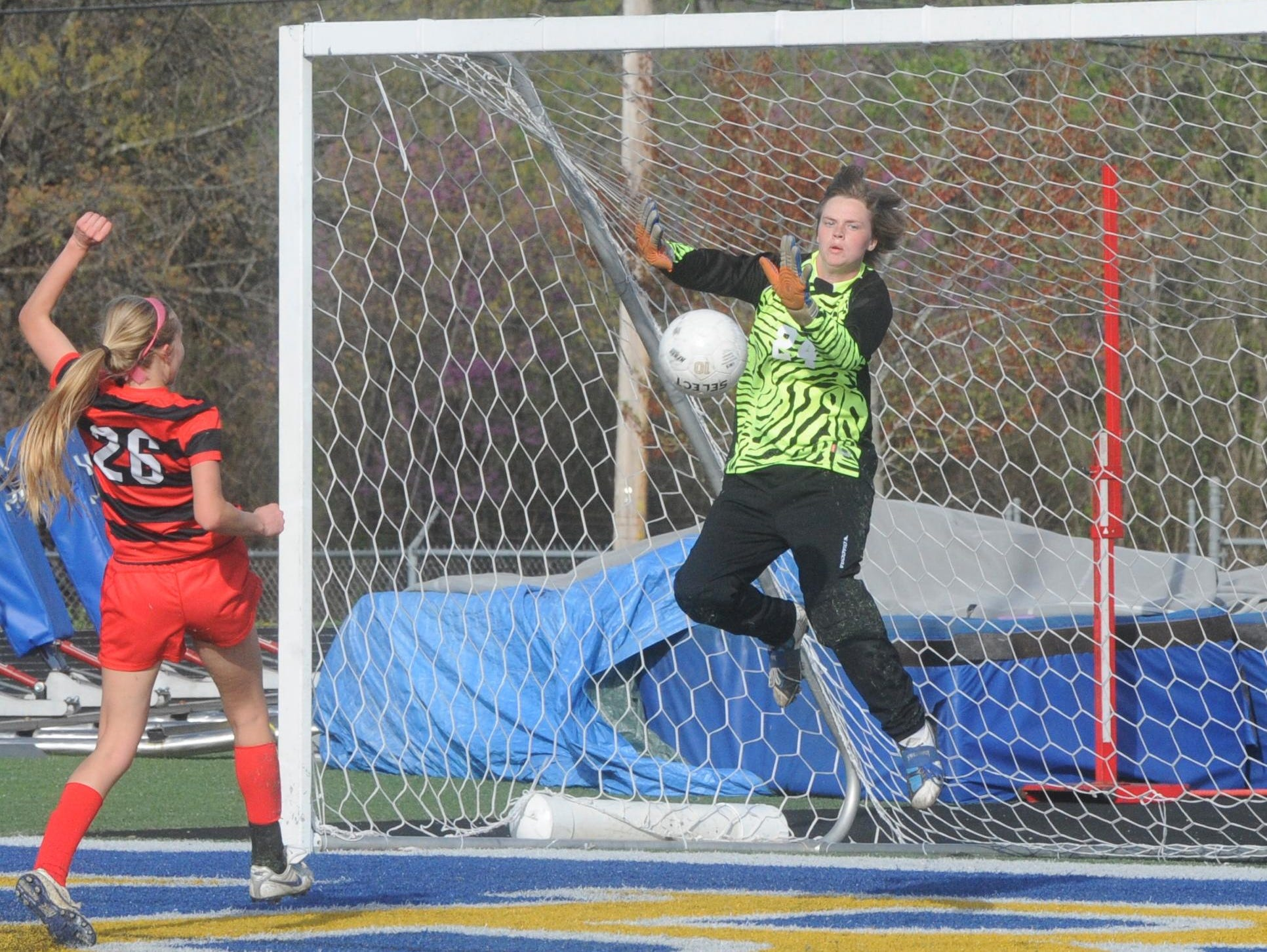 Mountain Home's Kira Bailey makes a save during a match against Cabot last season. Bailey played goalkeeper for the East squad in the Arkansas High School Coaches Association's all-star girls' soccer match on Wednesday night at Conway.