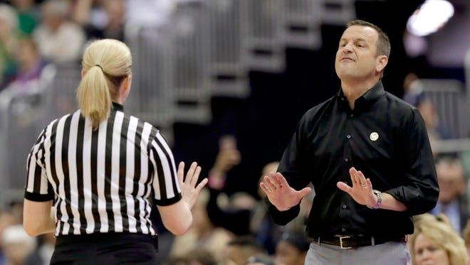 Louisville head coach Jeff Walz argues with an official during the first half against Mississippi State in the semifinals of the women's NCAA Final Four college basketball tournament, Friday, March 30, 2018, in Columbus, Ohio.