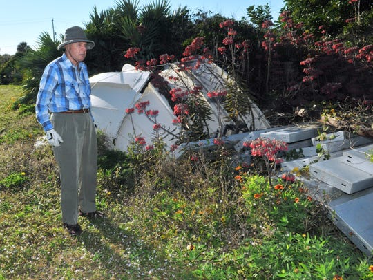 Bob Nolan stands next to what is left of the old Air Force tracking station dome that had been used in Melbourne Beach for tracking launches through the years. it is now in a pile next to the Old Town Hall History Center, after being taken down in 2008.