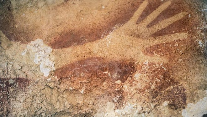 Scientists say this human handprint is almost 40,000 years old -- the oldest-known cave stencil.