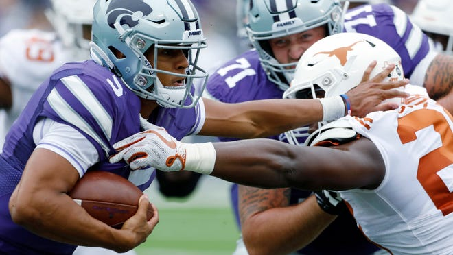 Kansas State quarterback Alex Delton (5) attempts to get past Texas linebacker Jeffrey McCulloch (23)during the first quarter of a college football game in Manhattan, Kan., Saturday, Sept. 29, 2018. (AP Photo/Colin E. Braley)