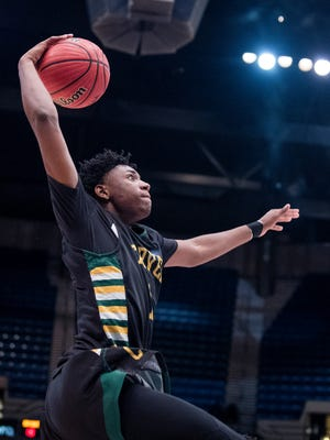 Carver's Jaykwon Walton dunks against Paul Bryant in their AHSAA State Championship Game at Legacy Arena in Birmingham, Ala. on Saturday March 3, 2018.