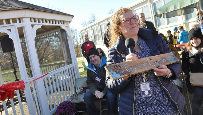 West Ridge Elementary school Teachers, students and family members dedicated a gazebo in honor of Randee Gerson, a special education teacher who lost her battle with endometrial cancer in 2015. Randee Gerson had been teaching in the borough for 12 years. Christine Dunay a collogue and friend of Gerson holds the Gerson Gazebo Plaque at the event in Park Ridge, NJ. November 23, 2016.