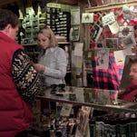 In this 1995 file photo, Nancy Hargrave, a saleswoman at Muxworthy's Ski Loft, helps Wendy Szczesniak of Geneseo pick out a ski jacket.