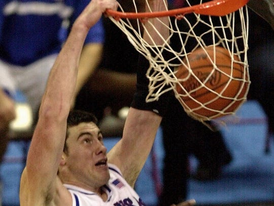 Nick Collison dunks for two of his 25 points against Oregon during the NCAA Midwest Regional final at the Kohl Center in Madison, Wis., Sunday, March 24, 2002.
