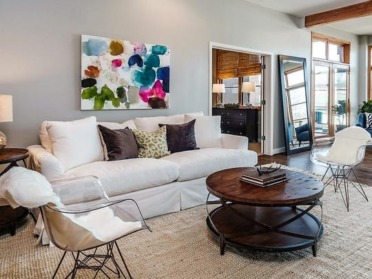 A living room after Next Home Staging & Design owners