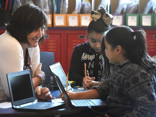Third grade teacher Kim Dean spends more one-on-one