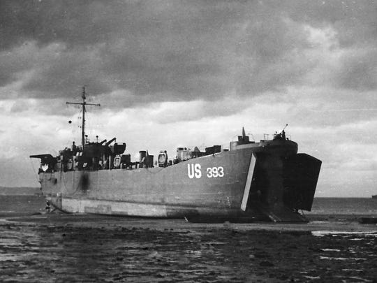 USS LST 393 stranded by retreating tides in Normandy during the D-Day invasion, July 1944.