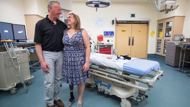 Scot and Leeann Krayenhagen pose for a portrait in a trauma room at the Medical Center of the Rockies in Loveland on Thursday, March 22, 2018. Leeann credits the quick action from a pair of medical providers in saving her life after she was seriously injured in a motorcycle accident last year.