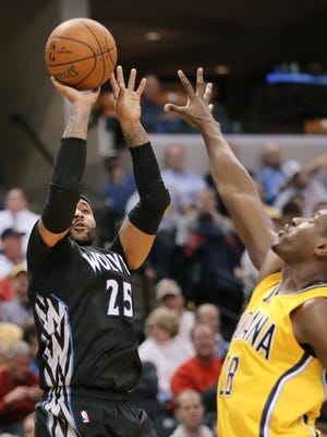 Minnesota guard Mo Williams takes a shot over Pacer center Ian Mahinmi in the second half of the game at Bankers Life Fieldhouse on Tuesday, Jan. 13, 2015. The Pacers lost 101-110 to the Minnesota Timberwolves but Williams scored 52 points on the day.