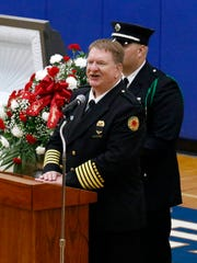 Huntington Township Fire Chief Larry Cuckler speaks during the funeral for firefighter Joseph Patterson Friday, June 29, 2018, at Southeastern High School. Patterson worked for Huntington Township and Paint Creek Joint Fire District.