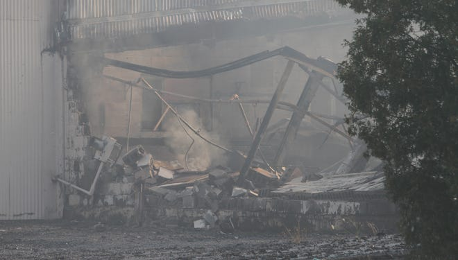 A century-old building once owned by an Ontario County construction company has been demolished after a fire ripped through the 31/2-story structure Thursday morning.