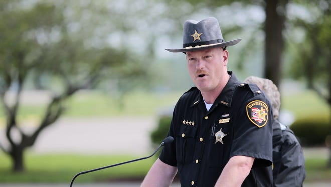 Pike County Sheriff Charles Reader gives an update on the Rhoden murders at an April 27 press conference at the makeshift command center in Waverly.