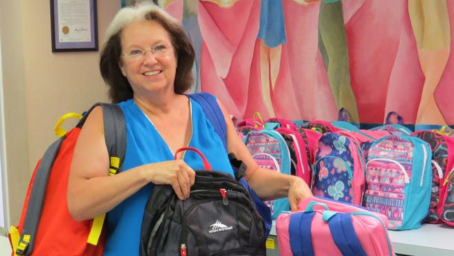 The United Way of Greater Philadelphia and Southern New Jersey recently provided 75 new, filled school backpacks to Court Appointed Special Advocates for Children of Atlantic and Cape May Counties. The backpacks will be given to children living in foster care. CASA volunteer Kathi Tetley of Northfield is pictured selecting backpacks for the children she advocates for.