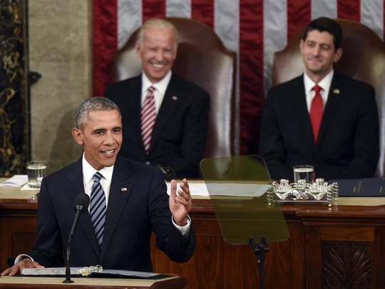 Vice President Joe Biden and House Speaker Paul Ryan listen as President Barack Obama gives his State of the Union address to a joint session of Congress on Capitol Hill on Tuesday, Jan. 12.