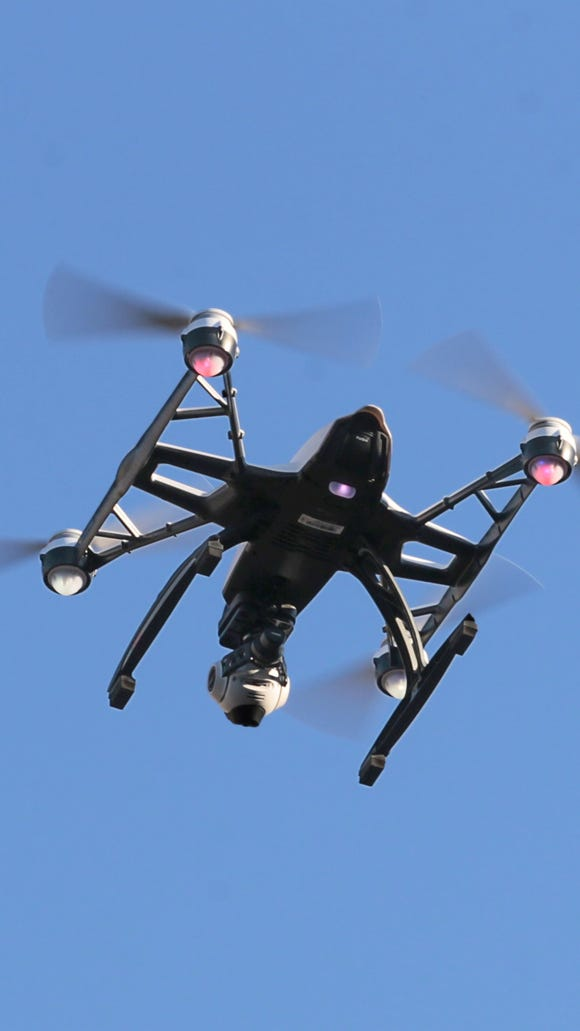 In this 2015 file photo, a small UAV flies in Rochester.