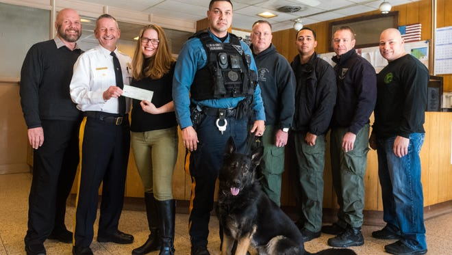 Vineland police dog Agir  poses for a photo with members of the department as Chief Rudy Beu is presented a check by 4Heroes Charity President Daneen Whinna and Chairman Les Whinna at the Vineland Police Station on Tuesday, January 9.