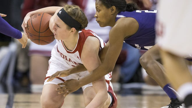 FILE -- Amanda Cahill (left), of Indiana, gathers a loose ball against Christen Inman of Northwestern, Big Ten Women's Basketball Tournament, Bankers Life Fieldhouse, Indianapolis, Friday, March 4, 2016. Northwestern won 79-73.