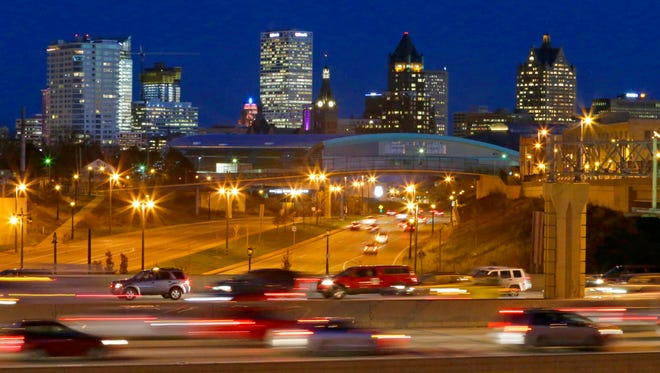 The Milwaukee skyline looking east along W. McKinley Ave. over I-43 toward the new arena on Nov. 29.