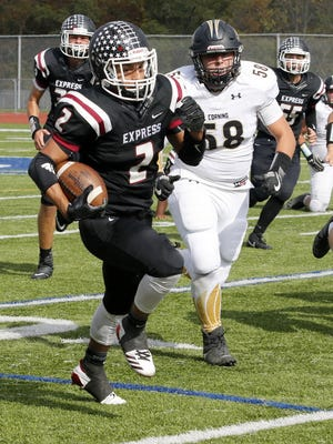 Airihk Ashley runs for a touchdown for Elmira in a 53-28 victory over Corning on Saturday at Ernie Davis Academy.