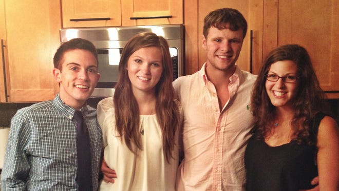 From left, Chris Colloton, Maggie Feazell, Otto Warmbier and Alex Abel. Colloton knew Warmbier since preschool. The community of Wyoming, Ohio, gathers Thursday, June 22, 2017, to mourn Warmbier, who died Monday, June 19, 2017.