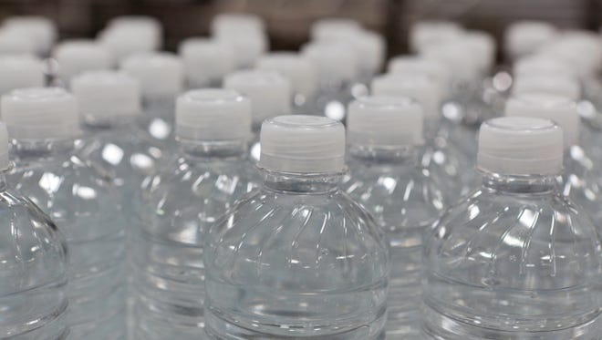 Close-up view of bottles of water.