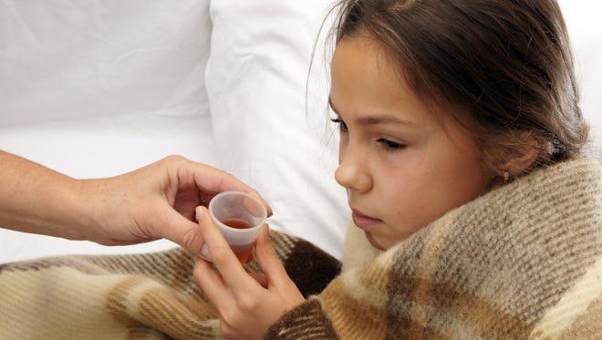 Girl takes medicine