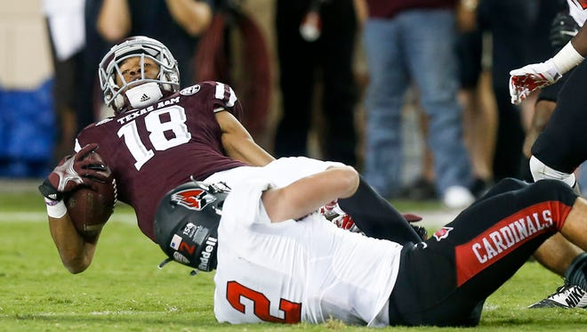 Texas A&M wide receiver Edward Pope (18) is tackled by Ball State linebacker Zack Ryan (2) during an NCAA college football game Saturday, Sept. 12, 2015, in College Station, Texas. Texas A&M won 56-23.