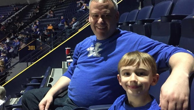 """Trapper McCarley, 8, enjoys his first college basketball experience with his dad, Daniel. It doesn't matter that they are in the nosebleed seats and Kentucky isn't playing. """"I think it's really cool,"""" Trapper said. """"I like being at the top."""""""