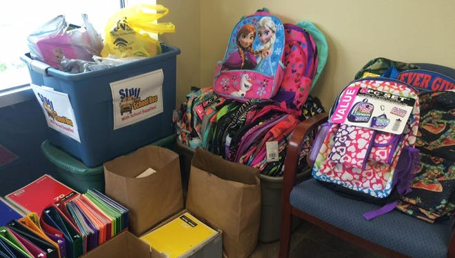 Readers donated backpacks, notebooks, folders and other school supplies at the Daily Tribune office for the 2016 Stuff the School Bus drive.
