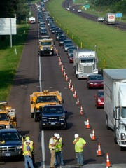 Some traffic delays are inevitable when a lane is closed, like here when a  sinkhole closed traffic in 2013 on Route 30 in York County. But some states have had success reducing delays in construction zones by encouraging motorists to use both lanes until the merge point -- called late lane merging or the zipper merge.