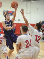 Wylie's Dylan Isenhower, left, drives to the basket