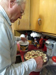 Bob readies apple slices for the dehydrator.